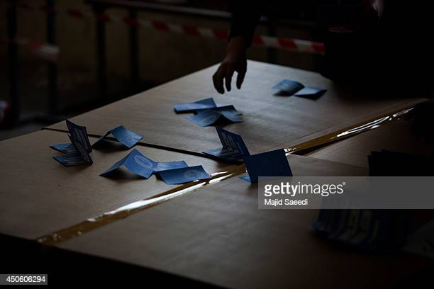 Independent Election Commission employees count ballots at a polling station in Kabul Afghanistan Saturday June 14 2014 Despite a Taliban threat to...