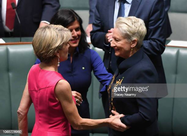 Independent Kerryn Phelps is hugged by former deputy PM Julie Bishop and Chisholm MP Julia Banks as she is officially sworn into parliament at...