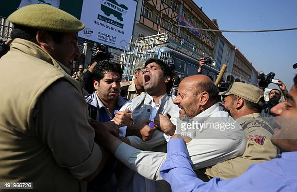 Independent lawmaker Engineer Sheikh Rashid scuffles with Indian police near the Legeslative Assembly during a protest against legislators from the...