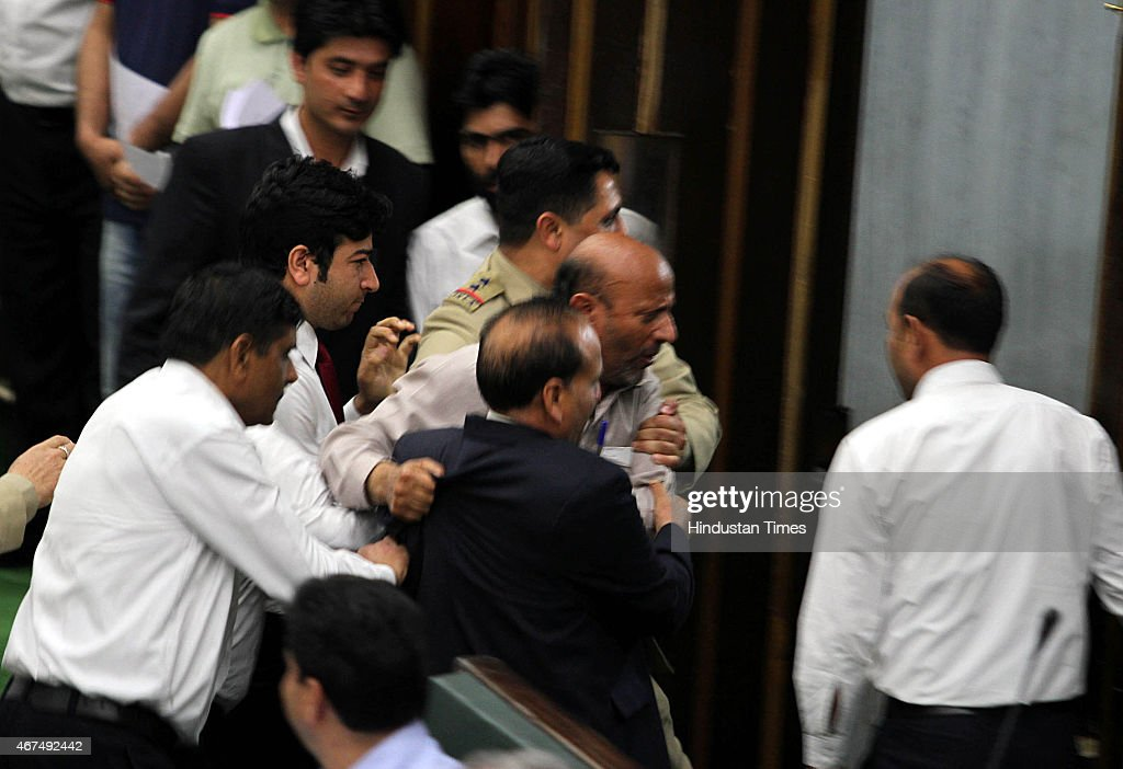 Independent MLA Abdul Rashid being marshaled out during a Budget session on March 25, 2015 in Jammu, India. Jammu and Kashmir Assembly witnessed ruckus after ruling BJP and PDP members slammed National Conference member Javed Rana for accusing Speaker Kavinder Gupta of being biased and demanded action against him.