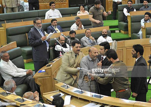Independent MLA from Langate Engineer Sheikh Abdul Rashid being marshaled out during a presentation of Budget on May 30 2016 in Srinagar India Since...