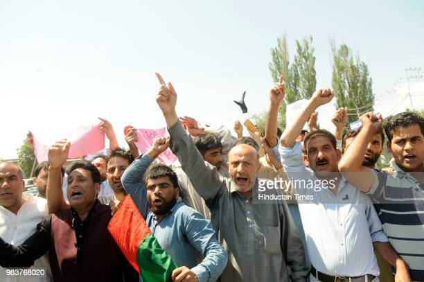 Independent MLA Sheikh Abdul Rashid along with his supporters shout slogans inside a police vehicle after being detained during a protest against the...