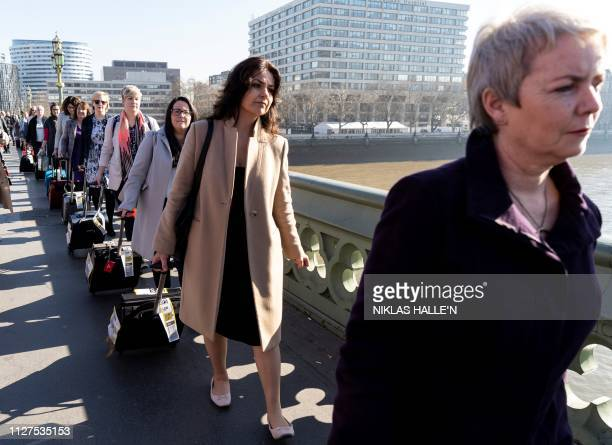 Independent MP Heidi Allen joins demonstrators pulling suitcases to symbolise the women who travel from Northern Ireland to Great Britain for a...