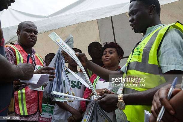 Independent National Electoral Commission officers begin the counting of vote in a polling station of Port Harcourt in Nigeria on April 11 2015...