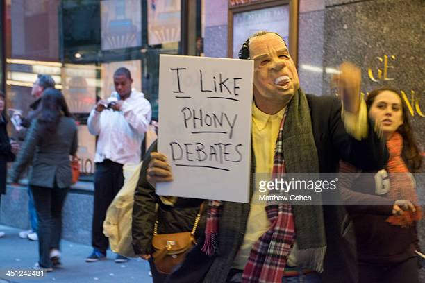 Independent New York City Mayoral Candidate Randy Credico protests outside 30 Rock wearing a Richard Nixon mask before the final debate between Bill...