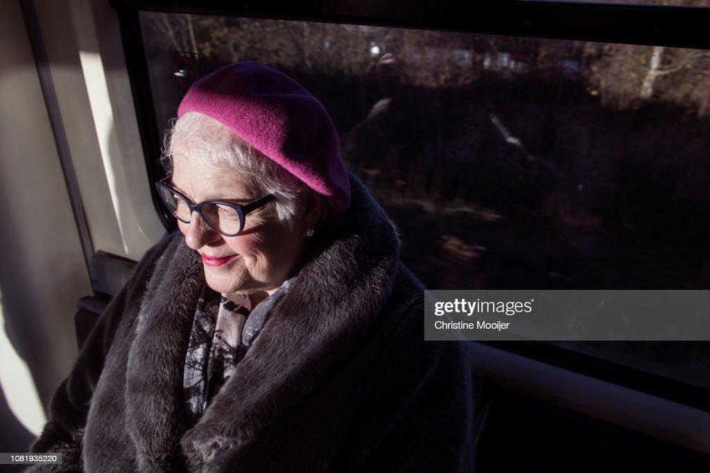 Independent older woman using public transport