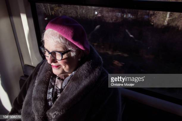 Independent older woman using public transport