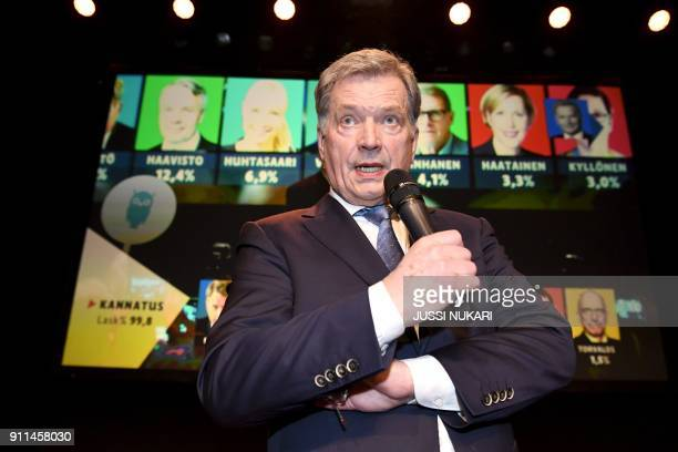 TOPSHOT Independent presidential candidate and current president Sauli Niinisto greets and thanks his supporters during an election reception in...