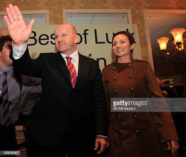 Independent presidential candidate Sean Gallagher and his wife Trish Gallagher waves as he speaks with supporters in Cavan on October 26 2011 during...