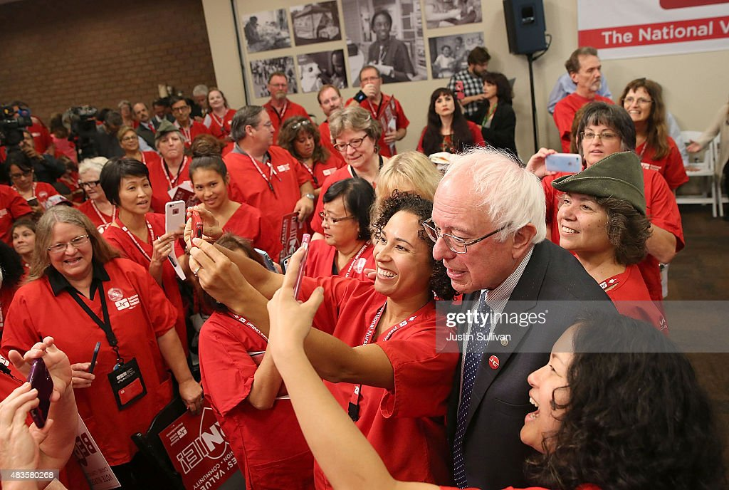 Independent presidential candidate U.S. Sen. Bernie Sanders (I-VT) takes a selfie with nurses from the National Nurse United during a 'Brunch with Bernie' campaign rally at the National Nurses United offices on August 10, 2015 in Oakland, California. The National Nurses United members announced their endorsement for independent presedential candidate Sen. Bernie Sanders during a campaign stop before he heads to Los Angeles for a campaign rally in Los Angeles at the Memorial Sports Arena.