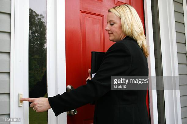 independent saleswoman ringing doorbell - ringing doorbell stock pictures, royalty-free photos & images