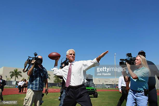 Independent Senatorial candidate Florida Governor Charlie Crist throws a football while attending a home coming event at Everglades High School on...