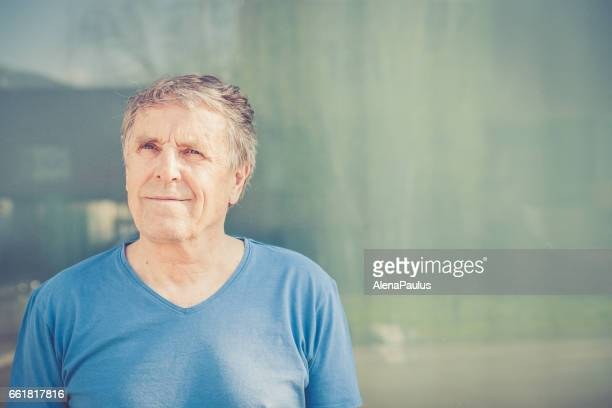 Independent Senior man with gray hair portrait outdoors