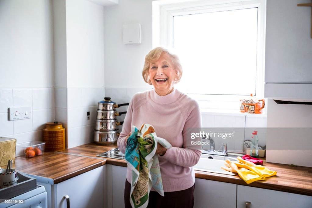 Independent Senior Woman in her Kitchen : Stock Photo
