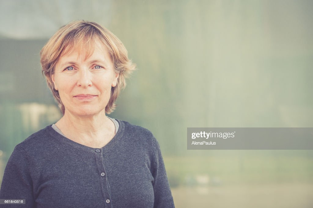 Independent Senior woman with short hair portrait outdoors : Stock Photo