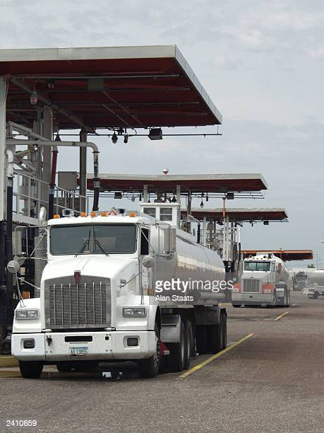 Independent tanker trucks are loaded with gasoline at the KinderMorgan tank farm August 19 2003 in southwest Phoenix Arizona After a gasoline...