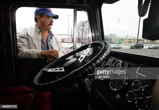 Independent trucker Jose Luis Martinez waits outside a Terminal Island ship dock for the lockout of West Coast longshoremen to end on Tuesday Oct 1...