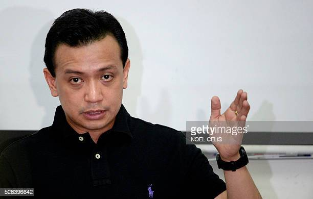 Independent vice presidential candidate Antonio Trillanes answers questions during an ambush interview after his press conference at the Magdalo...