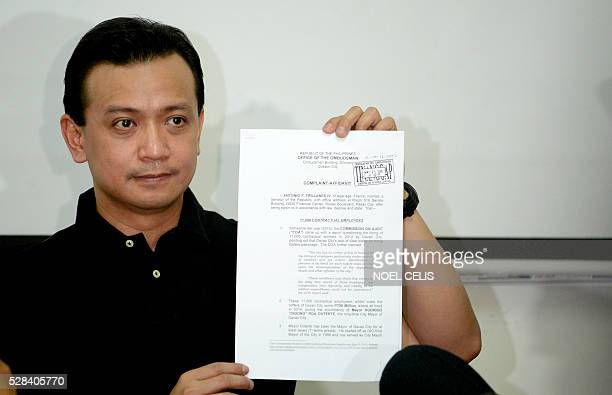 Independent vice presidential candidate Antonio Trillanes shows a plunder charges that he will file against presidential candidate and Davao Mayor...