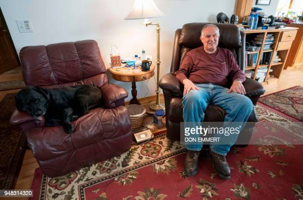 Independent Wildlife Biologist Ben Kilham and his dog Sophie relax at his home on March 29 2018 in Lyme New Hampshire Kilham with help from his...