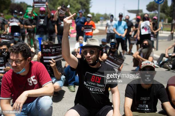 Independent workers protest against the government's economic policy next to the Ministry of Finance on June 22, 2020 in Jerusalem, Israel. The...