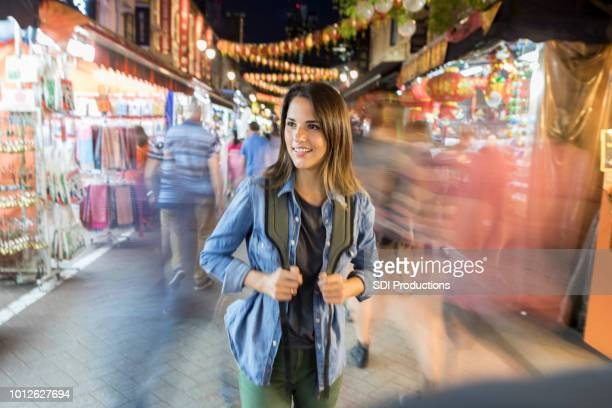 independent young woman explores market in singapore - chinatown stock photos and pictures