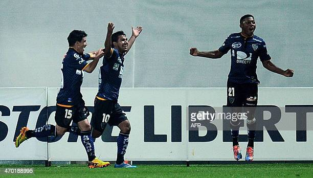 Independiente del Valle's Junior Nazareno celebrates his goal with Mario Rizotto and Jonathan Gonzalez against Union Espanola from Chile during their...