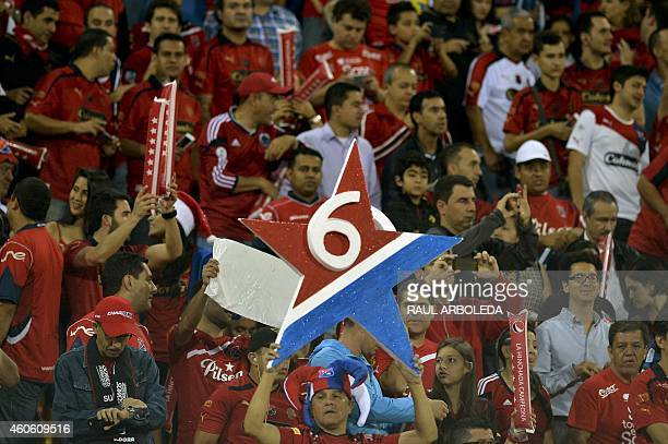 Independiente Medellin's supporters cheer for their team before the start of their Colombian Football League first leg final match against...