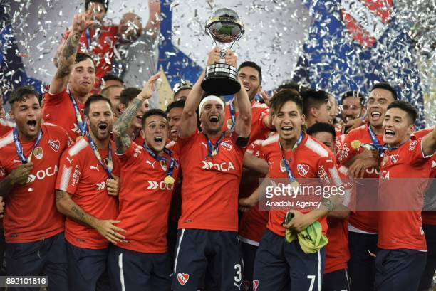 Independiente player Walter Erviti rears the Cup and celebrates the victory with his teammates after the 2017 Sudamericana Cup championship final...