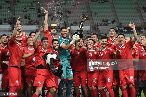 Independiente players and staffs celebrate after the Suruga Bank Championship match between Cerezo Osaka and Independiente at Yanmar Stadium Nagai on...