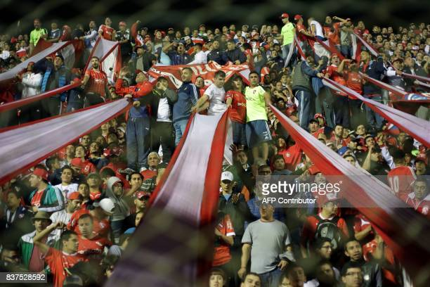 Independiente supporters cheer for their team during their Copa Sudamericana match against Atletico Tucuman at the Jose Fierro stadium in Tucuman...