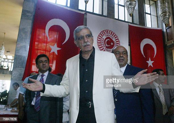 Indepented candidate and leader of the Democratic Society Party Ahmet Turk gestures during their registrations at the Turkish parliament in Ankara 29...