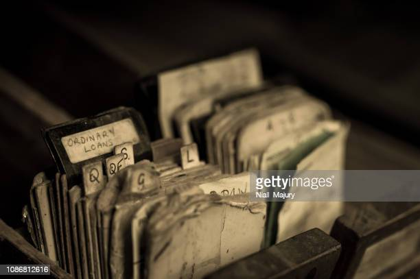 index cards from an abandoned library card catalogue cabinet - archival stock pictures, royalty-free photos & images