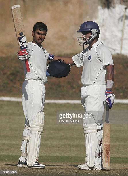 India A batsman Subramaniath Badrinath is congratulated by teammate Arjun Yadav after he hit a century against Kenya 11 August 2007 at Mombasa Sports...