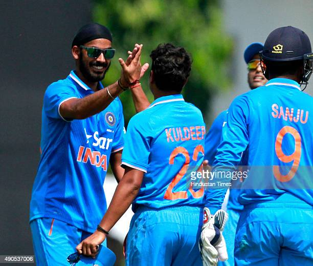 India A bowler Hardik Pandya celebrates with teammates after bowling out South African batsman David Miller during the practice of T20 match between...