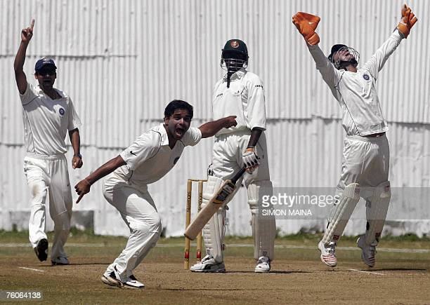 India A bowler Rajesh Pawar Mohamed Kaif and Mahesh Rawat wicket keeper appeals unsuccesfully for caught behind against Kenya's Tony Suji 12 August...