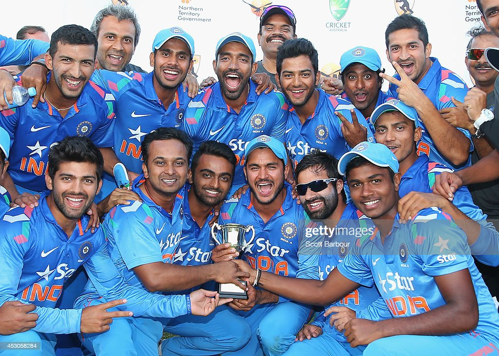 India 'A' celebrate with the trophy after winning the match during the Cricket Australia Quadrangular Series Final match between Australia 'A' and India 'A' at Marrara Oval on August 2, 2014 in Darwin, Australia.