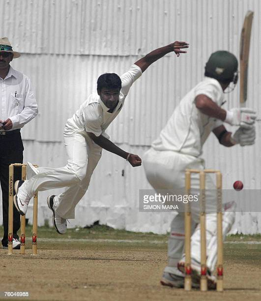 India A team bowler Yo Mahesh bowls against Kenya's batsman Tanmay Mishra 10 August 2007 during their threeday match at Mombasa Sports Club India has...