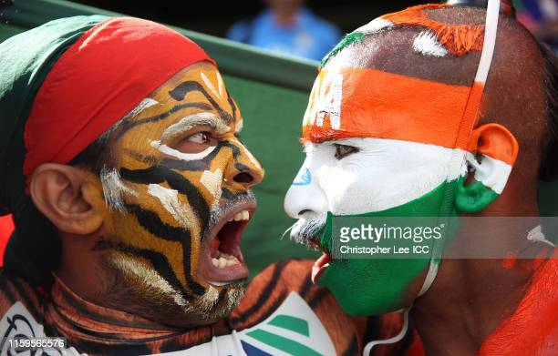 India and Bangladesh fans take part in a stare off as they pose for a photo during the Group Stage match of the ICC Cricket World Cup 2019 between...