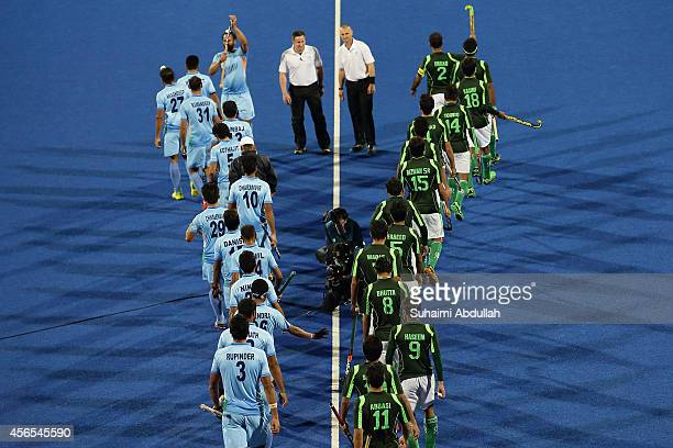 India and Pakistan players enter the pitch during the men's gold medal match on day thirteen of the 2014 Asian Games at Seonhak Hocky Stadium on...