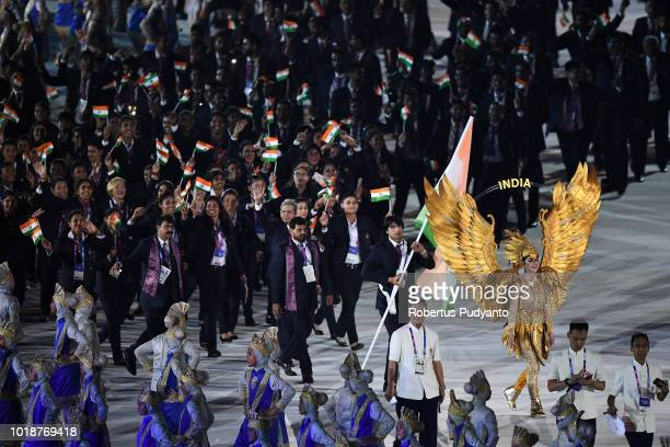 India athletes walk in the parade during the opening ceremony of the Asian Games 2018 at Gelora Bung Karno Stadium on August 18 2018 in Jakarta...