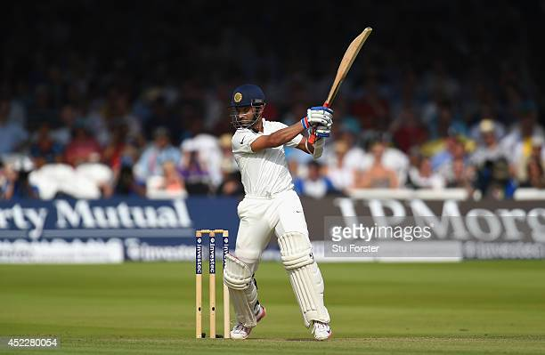 India batsman Ajinkya Rahane cuts a ball to the boundary during day one of 2nd Investec Test match between England and India at Lord's Cricket Ground...