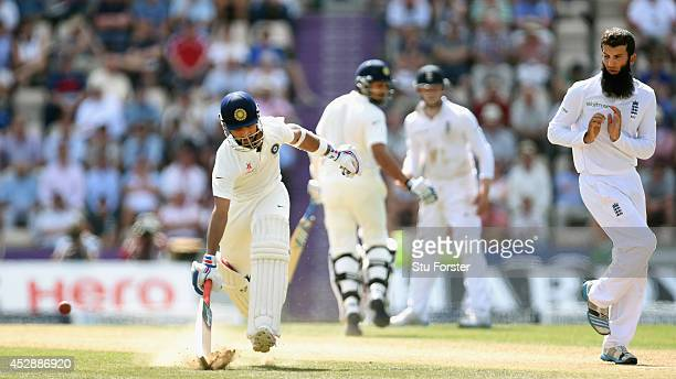 India batsman Ajinkya Rahane makes his ground as bowler Moeen Ali takes evasive action during day three of the 3rd Investec Test between England and...