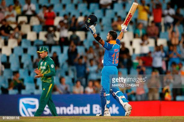 India batsman and captain Virat Kohli celebrates after scoring a century during the sixth One Day International cricket match between South Africa...