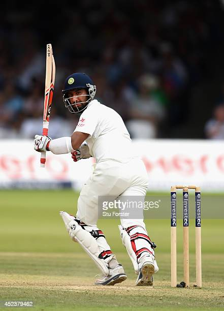 India batsman Cheteshwar Pujara hits a boundary during day three of 2nd Investec Test match between England and India at Lord's Cricket Ground on...