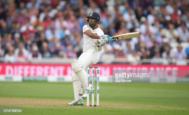 India batsman Cheteshwar Pujara pulls a ball straight to Adil Rashid for 14 runs during day one of the 3rd Specsavers Test Match between England and...