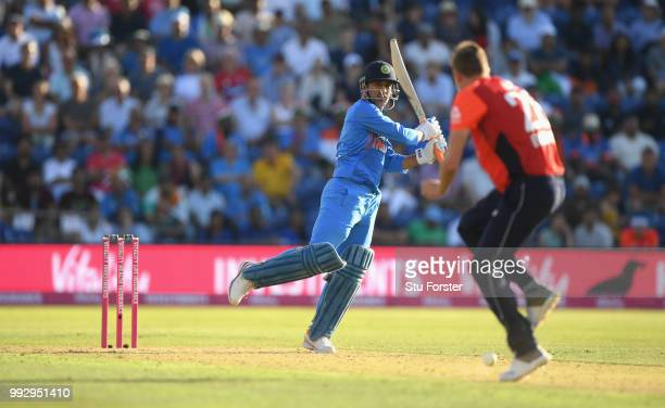 India batsman MS Dhoni clubs the ball past England bowler Jake Ball during the 2nd Vitality T20 International between England and India at Sophia...