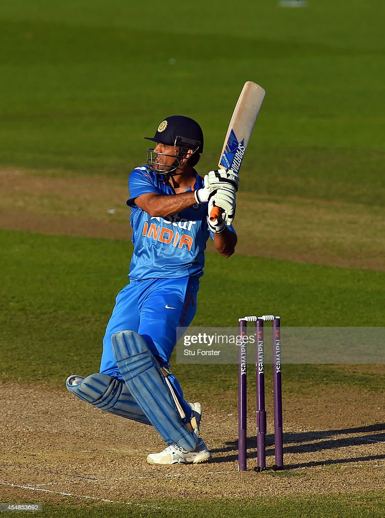 India batsman MS Dhoni hits out during the NatWest T20 International between England and India at Edgbaston on September 7, 2014 in Birmingham, England.