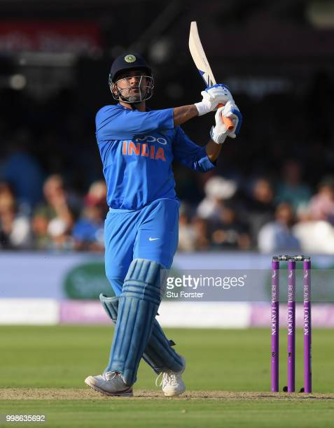 India batsman MS Dhoni hits out only to be caught on the boundary during the 2nd ODI Royal London One Day International match between England and...