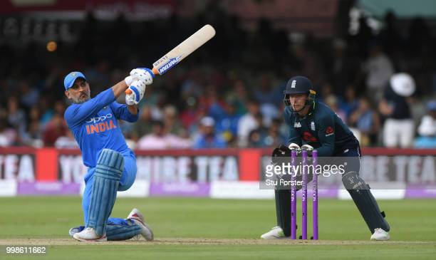 India batsman MS Dhoni hits out watched by Jos Buttler during the 2nd ODI Royal London One Day International match between England and India at...